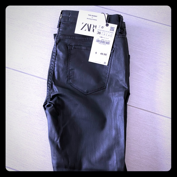 Skinny black coated jeans